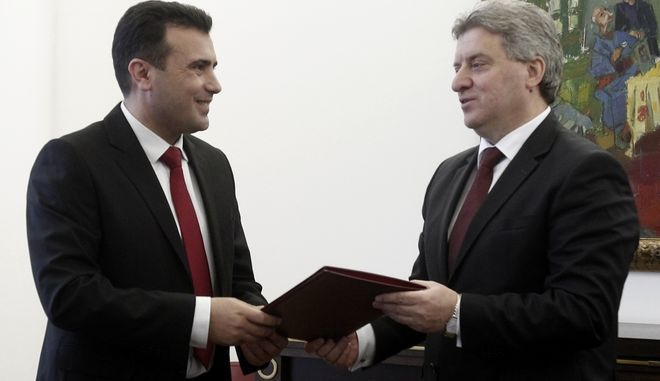 Zoran Zaev, left, leader of the opposition Social Democrats, presents to the President Gjorge Ivanov, right, the signatures from lawmakers to form the new Macedonian Government, in the capital Skopje, on Monday, Feb. 27, 2017. Macedonia's left-wing opposition leader submitted signatures from three ethnic Albanian parties on Monday as proof he has secured enough support in parliament to form a government. (AP Photo/Boris Grdanoski)