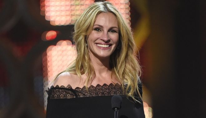 FILE - In this June 4, 2016, file photo, Julia Roberts accepts the woman of the decade award at the Guys Choice Awards in Culver City, Calif. The Hollywood Reporter said on Dec. 15, 2016, that Roberts would be taking on her first regular TV role in a miniseries adaptation of Maria Semples novel, Today Will Be Different. (Photo by Chris Pizzello/Invision/AP, File)