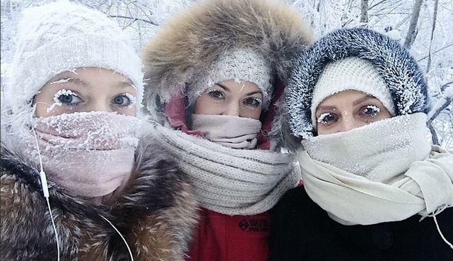 CORRECTS DATE In this photo taken on Saturday, Jan. 13, 2018, Anastasia Gruzdeva, left, poses for selfie with her friends as the temperature dropped to about -50 degrees (-58 degrees Fahrenheit) in Yakutsk, Russia. Temperatures in the remote, diamond-rich Russian region of Yakutia have dropped to near-record lows, plunging to -67 degrees Centigrade (-88.6 degrees Fahrenheit) in some areas. (sakhalife.ru photo via AP)