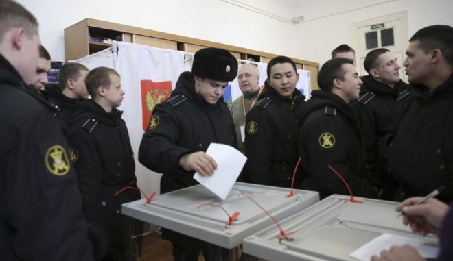 Russian military sailors cast their ballots at a polling station in the Russian Far Eastern port city of Vladivostok, Russia, Sunday, March 18, 2018. Polls have opened in Russia's Far East regions for the presidential election in which Vladimir Putin is seeking a fourth term in the Kremlin. (AP Photo)