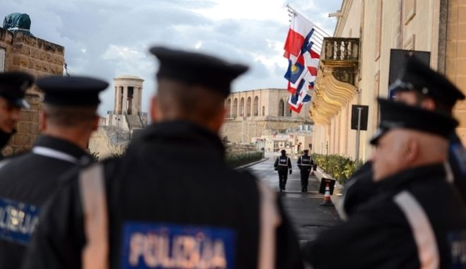 Police officers patrol outside the Mediterranean Conference Centre where the CHOGM (Commonwealth heads of Government meeting) is scheduled to open in Valletta, Malta, Friday, Nov. 27, 2015. (AP Photo/Rene Rossignaud)