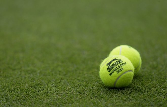 Tennis balls emblazoned with Wimbledon 2013 are placed on a court during a match at the All England Lawn Tennis Championships at Wimbledon, London, Monday, June 24, 2013. (AP Photo/Alastair Grant)  ORG XMIT: WIM111