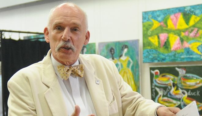 Janusz Korwin-Mikke, leader of the far right and eurosceptic Congress of the New Right Wing party gestures as he casts his ballot at a polling station during the European Parliament elections in Jozefow, near  in Warsaw, Poland, Sunday, May 25, 2014. (AP Photo/Alik Keplicz)