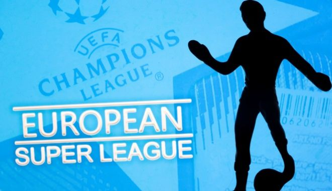"""A metal figure of a football player with a ball is seen in front of the words """"European Super League"""" and the UEFA Champions League logo in this illustration taken April 20, 2021. REUTERS/Dado Ruvic/Illustration"""