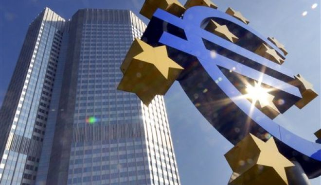 ** FILE ** A Euro sculpture is seen in the autumnal sun in front of the European Central Bank ECB building, background, in Frankfurt, Germany, on Sept. 24, 2007. The euro soared higher on Wednesday, Feb. 27, 2008, climbing to a high of US$1.5057 in early European trading as sentiment that the U.S. Federal Reserve would continue its rate cut campaign intensified when its chairman testifies before the U.S. Congress. (AP Photo/Bernd Kammerer)