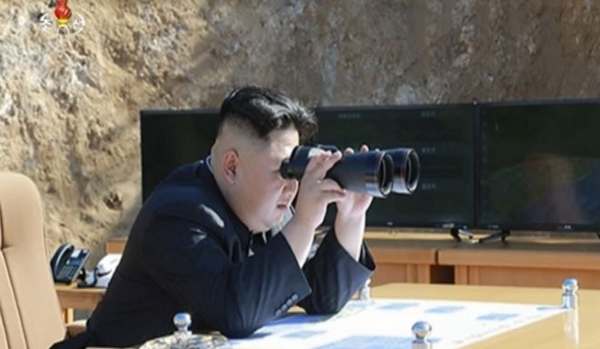 This image made from video of a news bulletin aired by North Korea's KRT on Tuesday, July 4, 2017, shows what was said to be North Korea leader Kim Jung Un, center, using binoculars to watch the launch of a Hwasong-14 intercontinental ballistic missile, ICBM, in North Korea's northwest. Independent journalists were not given access to cover the event depicted in this photo. North Korea claimed to have tested its first intercontinental ballistic missile in a launch Tuesday, a potential game-changing development in its push to militarily challenge Washington  but a declaration that conflicts with earlier South Korean and U.S. assessments that it had an intermediate range. (KRT via AP Video)