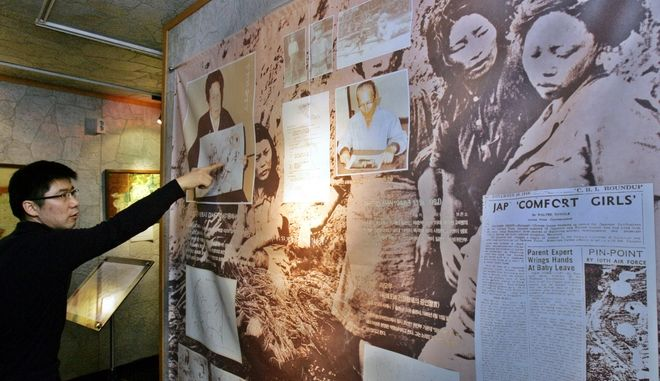 """An unidentified South Korean visitor looks at a picture showing Korean comfort women who served as a sexual slave for the Japanese Imperial Army during the World War II, at the Historical Museum of Sexual Slavery by the Japanese Military in Gwangju, south of Seoul, Tuesday, March 6, 2007. Calls for Japan's apology for these so-called """"comfort women"""" flared anew last week after Japanese Prime Minister Shinzo Abe said there was no proof that the women were coerced into prostitution. (AP Photo/Ahn Young-joon)"""