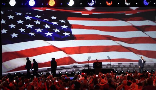 Singer Lee Greenwood, right, sings ahead of President Donald Trump speech during the National Rifle Association-ILA Leadership Forum, Friday, April 28, 2017, in Atlanta. The NRA is holding its 146th annual meetings and exhibits forum at the Georgia World Congress Center. (AP Photo/Mike Stewart)