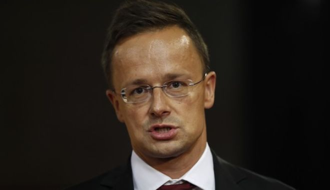 Hungarian Minister of Foreign Affairs and Trade Peter Szijjarto addresses media after Russian President Vladimir Putin visited the World Judo Championships in Budapest, Hungary, Monday, Aug. 28, 2017. (AP Photo/Petr David Josek)