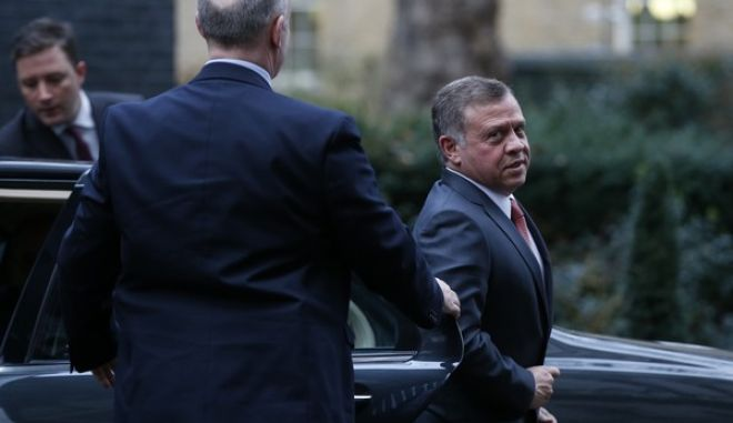 King Abdullah II of Jordan gets out of his car as he arrives in Downing Street for a meeting with Britain's Prime Minister Theresa May in London, Wednesday, March 1, 2017. (AP Photo/Alastair Grant)