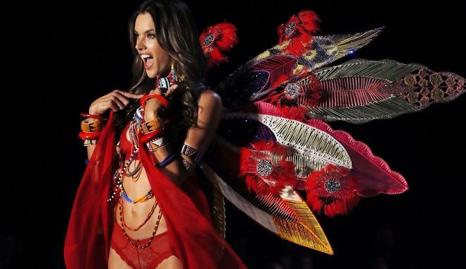 Brazilian Alessandra Ambrosio gestures as she presents a creation during the Victoria's Secret fashion show at the Mercedes-Benz Arena in Shanghai, China, Monday, Nov. 20, 2017. (AP Photo/Andy Wong)