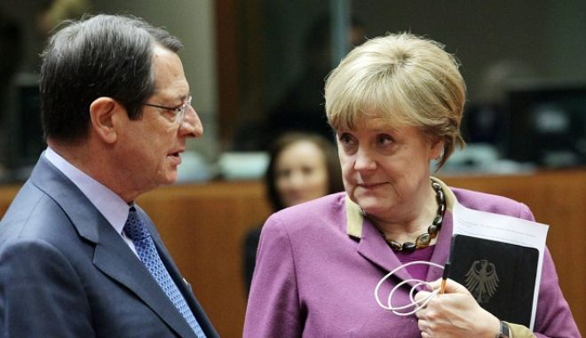epa03625441 Germany Federal Chancellor Angela Merkel (R) chats with Cyprus President Nicos Anastasiades during the second day of an EU summit at the European Council headquarters in Brussels, Belgium, 15 March 2013. French President Francois Hollande called on the European Union to lift an arms embargo running until May that has prevented the shipment of weapons to rebels in war-torn Syria, at talks on 14 March with his EU counterparts. Britain also has spoken in favour of providing more unequivocal support to the Syrian opposition, whereas German Chancellor Angela Merkel called for caution. The issue was added at the last minute to the leaders' agenda for 15 March.  EPA/OLIVIER HOSLET