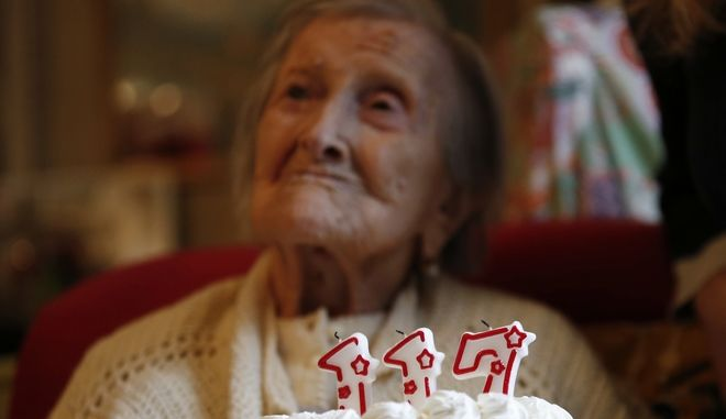 Emma Morano is pictured behind a cake with candles marking 117 years in the day of her birthday in Verbania, Italy, Tuesday, Nov. 29, 2016.  At 117 years of age, Emma is now the oldest person in the world and is believed to be the last surviving person in the world who was born in the 1800s, coming into the world on Nov. 29, 1899. (AP Photo/Antonio Calanni)