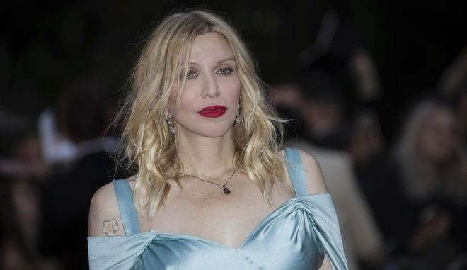 Courtney Love poses for photographers upon arrival at the GQ's Men of The Year awards, in London, Tuesday, Sept. 5, 2017. (Photo by Vianney Le Caer/Invision/AP)