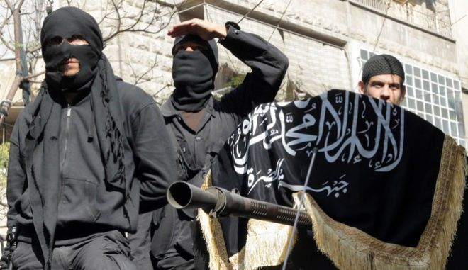 Members of jihadist group Al-Nusra Front take part in a parade calling for the establishment of an Islamic state in Syria, at the Bustan al-Qasr neighbourhood of Aleppo, on October 25, 2013. The conflict in Syria, which erupted after President Bashar al-Assad launched a bloody crackdown on Arab Spring-inspired democracy protests, is believed to have killed more than 115,000 people. AFP PHOTO / KARAM AL-MASRI        (Photo credit should read KARAM AL-MASRI/AFP/Getty Images)