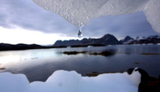 FILE - In this Tuesday Aug, 16, 2005 file photo an iceberg melts in Kulusuk, Greenland near the arctic circle. Scientists who are fine-tuning a landmark U.N. report on climate change are struggling to explain why global warming appears to have slowed down in the past 15 years even as greenhouse gas emissions keep rising. Leaked documents show there is widespread disagreement among governments over how to address the contentious issue in Sept. 23-26 stock-taking report by the Intergovernmental Panel on Climate Change. (AP Photo/John McConnico, File)