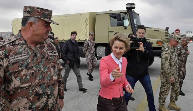 German Defence Minister Ursula von der Leyen, center, and Jordanian Chairman of the Joints Chief of Staff Mahmoud Freihat, left, walk past a Mercedes-Benz Zetro off-road truck during a ceremony handing over equipment to Jordan, at Marka airport, Amman, Jordan, Sunday, Jan. 14, 2018. Germany's defense minister handed over handed over 70 Mercedes trucks, 56 Mercedes mini vans and two training aircraft worth a total of $22 million to the Jordanian military during a visit to the kingdom. (John MacDougall/Pool Photo via AP)