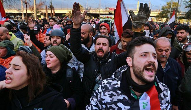 Από διαδήλωση στο Ιράκ.