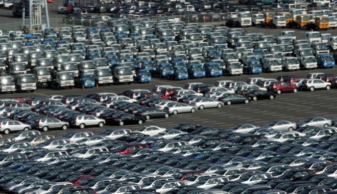 New Nissan cars await to be loaded onto a cargo ship at a logistics parking lot in Yokohama port, west of Tokyo, Monday, Feb. 21, 2005. Japan's economy squeezed out 0.1 percent growth during the October-December quarter, the government said Monday, March 14, 2005 in an upward revision of earlier data that had shown a contraction. The revised numbers show that the economy grew at an annualized rate of 0.5 percent during the quarter ending Dec. 31, 2004, and recorded growth after two straight previous quarters of contraction. (AP Photo/Katsumi Kasahara)