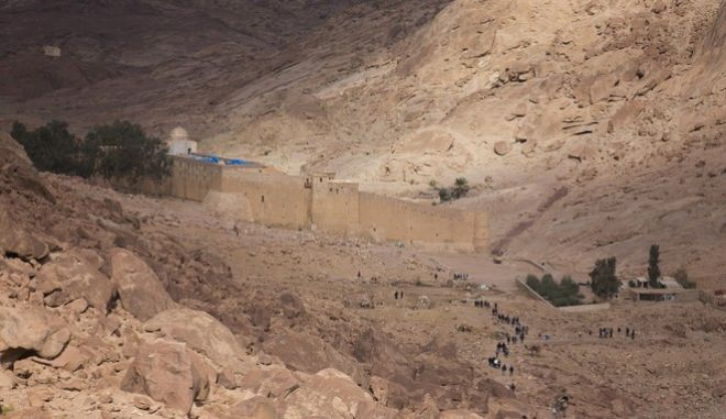 In this photo taken Sunday, Dec. 9, 2013, people arrive back at Saint Catherine's Monastery after visiting a Greek Orthodox Chapel and a mosque on top of Mount Sinai in Saint Catherine in the Sinai peninsula, Egypt. (AP Photo/Hiro Komae)