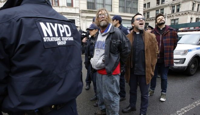 Protesters arrested demonstrating against the detention of prominent immigration activist Ravi Ragbir shout slogans as police prepare to lead them to squad cars, Thursday, Jan. 11, 2018, in New York. According to his attorney, Ragbir, a citizen of Trinidad, was handcuffed and detained by the federal government during a scheduled immigration check-in in lower Manhattan Thursday. Ragbir has been fighting deportation for years. (AP Photo/Kathy Willens)