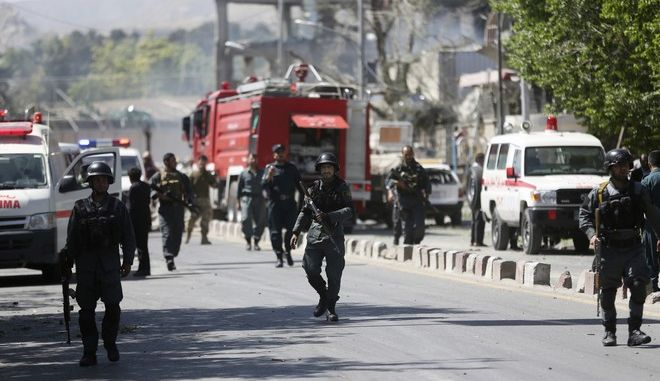 Security forces inspect near the site of a suicide attack in Kabul, Afghanistan, Wednesday, May 31, 2017. A massive explosion rocked a highly secure diplomatic area of Kabul on Wednesday morning, causing casualties and sending a huge plume of smoke over the Afghan capital. (AP Photos/Massoud Hossaini)