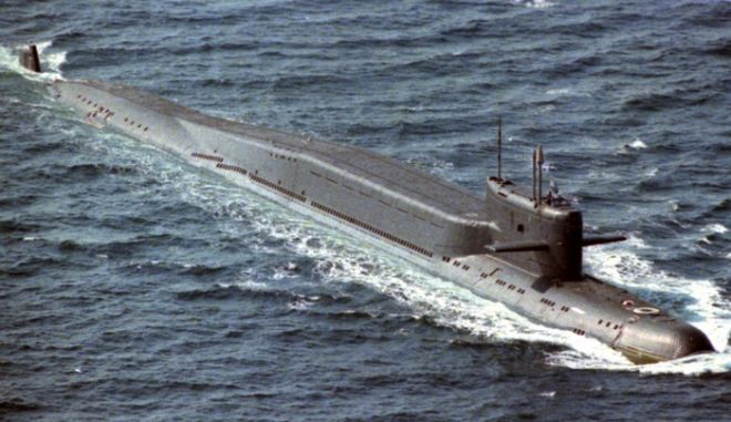 Aerial starboard bow view of a Russian Navy Northern Fleet Delta III class nuclear-powered ballistic missile submarine underway on the surface.