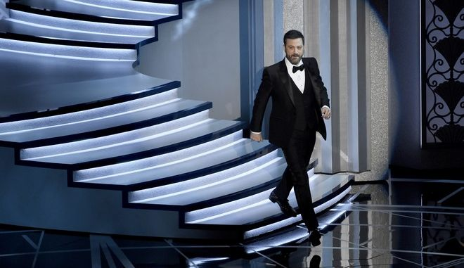 Host Jimmy Kimmel walks on stage at the Oscars on Sunday, Feb. 26, 2017, at the Dolby Theatre in Los Angeles. (Photo by Chris Pizzello/Invision/AP)