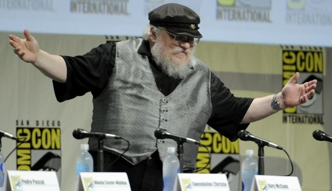 "George R.R. Martin attends the ""Game of Thrones"" panel on Day 2 of Comic-Con International on Friday, July 25, 2014, in San Diego. (Photo by Chris Pizzello/Invision/AP)"