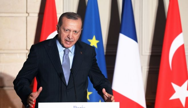 Turkish President Recep Tayyip Erdogan, delivers a speech during a press conference with French President Emmanuel Macron at the Elysee Palace in Paris, Friday, Jan.5, 2018. Erdogan is traveling to Paris for talks with Macron, amid protests over press freedom and the deteriorating state of human rights in Turkey. (Ludovic Marin, Pool via AP)