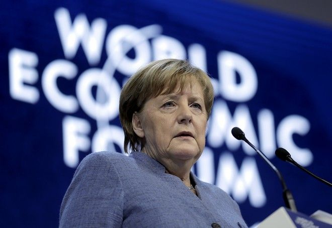 German Chancellor Angela Merkel looks to the audience during her special address as part of the annual meeting of the World Economic Forum in Davos, Switzerland, Wednesday, Jan. 24, 2018. (AP Photo/Markus Schreiber)