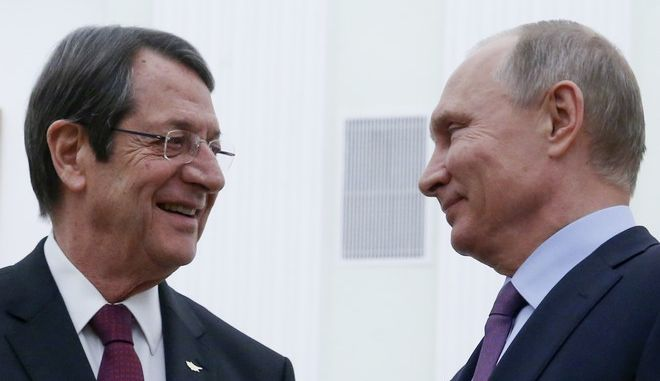 Russian President Vladimir Putin, right, and Cyprus' President Nicos Anastasiades talk to each other during their meeting in the Kremlin in Moscow, Russia, Tuesday, Oct. 24, 2017. Nicos Anastasiades arrived in Russia on a working visit. (Sergei Chirikov/Pool Photo via AP)