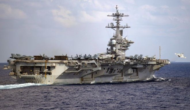 In this March 18, 2020, photo provided by the U.S. Navy, an F/A-18F Super Hornet launches from the flight deck of the aircraft carrier USS Theodore Roosevelt (CVN 71) in the western North Pacific Ocean. The Navys top admiral will soon decide the fate of the ship captain who was fired after pleading for his superiors to move faster to safeguard his coronavirus-infected crew on the USS Theodore Roosevelt.  (Mass Communication Specialist 3rd Class Nicholas V. Huynh/U.S. Navy via AP))