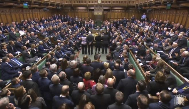 MPs in the House of Commons gather after a vote on a motion insisting a deal with the EU require an Act of Parliament before it can take effect, in London, Wednesday, Dec. 13, 2017. British lawmakers have delivered a defeat to Prime Minister Theresa May's Brexit plans by giving Parliament the final say on any exit agreement with the European Union. The House of Commons voted 309-305 on Wednesday to inserting Parliament in the Brexit process and deal another blow to May's already fragile authority. (PA via AP)
