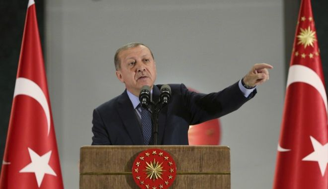 Turkey's President Recep Tayyip Erdogan, gestures as he delivers a speech at a dinner to break the Ramadan fast in Ankara, Turkey, Thursday, June 15, 2017. Erdogan has slammed the U.S. decision to arrest a dozen of his security guards and two others accused of taking part in a violent attack on protesters during his official visit to Washington, D.C., last month.(Presidency Press Service via AP, Pool)