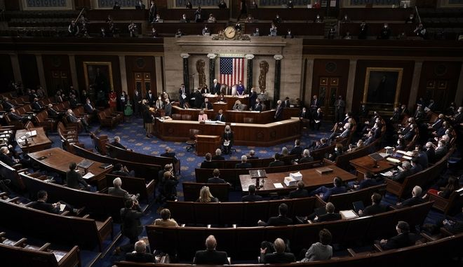 Speaker of the House Nancy Pelosi, D-Calif., and Vice President Mike Pence officiate as a joint session of the House and Senate convenes to confirm the Electoral College votes cast in November's election, at the Capitol in Washington, Wednesday, Jan. 6, 2021. (AP Photo/J. Scott Applewhite)