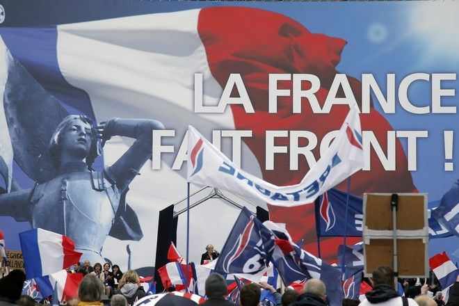 Frances far-right National Front president Marine Le Pen, center, delivers her speech at Opera Plaza during the annual May Day march, in Paris, France, Friday, May 1, 2015. Frances far-right National Front is holding its annual May Day march, but for the first time the partys founder Jean-Marie Le Pen is not taking a seat at the tribune. (AP Photo/Francois Mori)