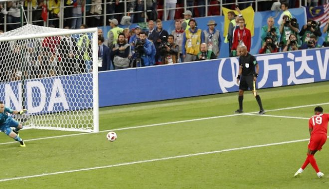 England's Marcus Rashford scores from the penalty spot