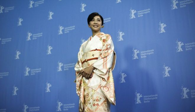 Actress Yuko Takeuchi poses for photographers during a photo call for the film 'Creepy' at the 2016 Berlinale Film Festival in Berlin, Germany, Saturday, Feb. 13, 2016. (AP Photo/Markus Schreiber)
