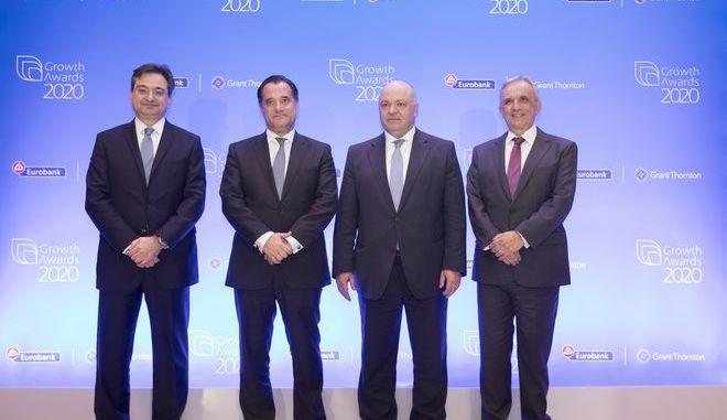 Από αριστερά προς τα δεξιά διακρίνονται οι κκ.: Φωκίων Καραβίας, Διευθύνων Σύμβουλος της Eurobank, Σπυρίδων - Άδωνις Γεωργιάδης, Υπουργός Ανάπτυξης & Επενδύσεων,  Γιώργος Ζανιάς, Πρόεδρος του Διοικητικού Συμβουλίου της Eurobank, Βασίλειος Καζάς, Διευθύνων Σύμβουλος της Grant Thornton.