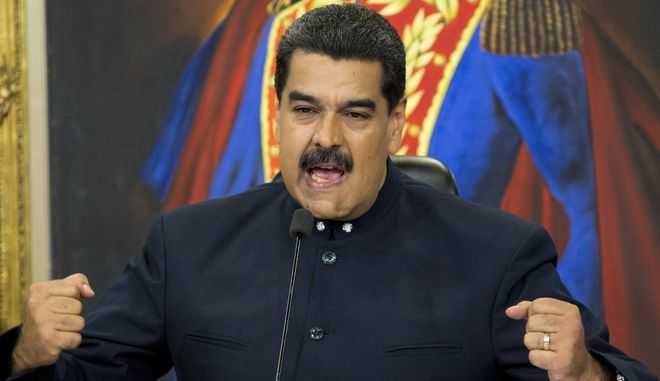 FILE - In this Oct. 17, 2017 file photo, Venezuela's President Nicolas Maduro speaks during a press conference at the Miraflores presidential palace, in Caracas, Venezuela. Maduro said Thursday, Nov. 2 2017, that his socialist government will begin restructuring a foreign debt estimated at more than $120 billion, saying U.S. financial sanctions are crippling the oil-dependent economys ability to pay. (AP Photo/Ariana Cubillos, File)
