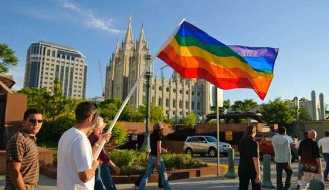 """In this Nov. 7, 2008 publicity image released by Red Flag Releasing, people gather to protest at Mormon headquarters and their support of California's 2008 Proposition 8, a ballot initiative banning gay marriage, in Salt Lake City.  The Mormon position on gay marriage is the focus of the documentary """"8: The Mormon Proposition"""". (AP Photo/Red Flag Releasing, David Daniels)"""