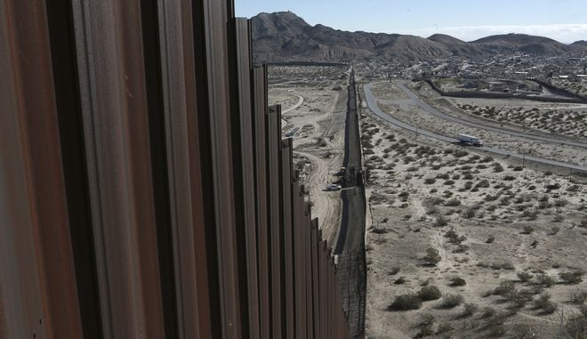 """In this Jan. 25, 2017 photo, a truck drives near the Mexico-US border fence, on the Mexican side, separating the towns of Anapra, Mexico and Sunland Park, New Mexico. On Wednesday, President Donald J. Trump promised """"immediate construction"""" would begin on the border wall, telling ABC News that planning is starting immediately. He again vowed that Mexico would pay the U.S. back, though he offered no details. (AP Photo/Christian Torres)"""