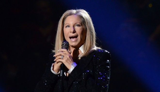 FILE - In this Oct. 11, 2012, file photo, singer Barbra Streisand performs at the Barclays Center in the Brooklyn borough of New York.  Officials say Streisand will serve as chair of a planned performing arts center at the World Trade Center. The announcement was made Thursday, Sept. 8, 2016 at a design-unveiling for the long-stalled project. (Photo by Evan Agostini/Invision/AP, File)