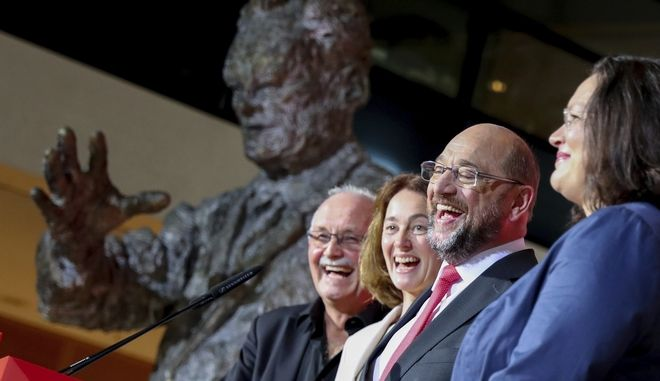 Social Democratic Party, SPD, leader Martin Schulz laughs after the first projection of the Lower Saxony state elections in Berlin, Sunday, Oct. 15, 2017. Beside him are German Families Minister Katarina Barley, second left, and SPD faction leader Andrea Nahles, right. The center-left Social Democrats are projected to win a vote in Germanys northern state of Lower Saxony. Initial projections by public broadcaster ARD put the Social Democrats of governor Stephan Weil ahead with 37.5 percent of the vote, ahead of Chancellor Angela Merkels Christian Democrats with 35 percent.  (Kay Nietfeld/dpa via AP)