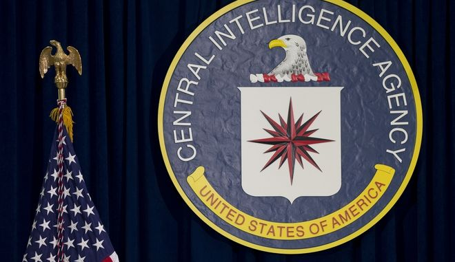 FILE - This April 13, 2016 file photo shows the seal of the Central Intelligence Agency at CIA headquarters in Langley, Va. A federal judge said Thursday, Jan. 19, 2017 that he's inclined to allow trial for a lawsuit against two psychologists who designed the CIA's harsh interrogation methods for the war on terror. The American Civil Liberties Union sued the psychologists on behalf of three former detainees, who claim they were tortured in CIA prisons. (AP Photo/Carolyn Kaster, File)