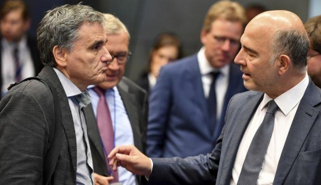 Ο Ε.Τσακαλώτος με τον Επίτροπο Μοσκοβισί