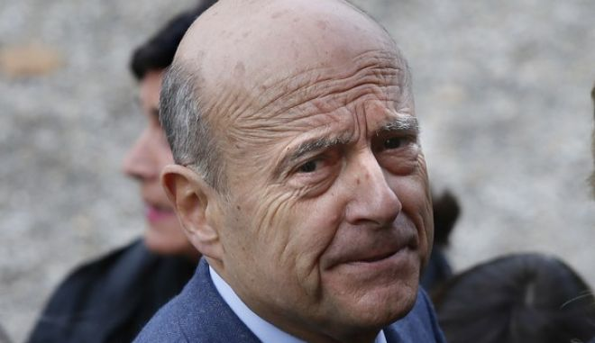 France's former prime minister and Bordeaux's mayor Alain Juppe, a candidate for France's upcoming presidential primary election, arrives at the polling station before voting at the conservative primary election in Bordeaux, southwestern France, Sunday, Nov. 20, 2016. French conservatives are voting in a nationwide primary to choose their nominee for next year's presidential election, after a campaign marked by concerns about immigration and Islamic extremism. (AP Photo/Bob Edme)