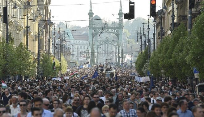 Participants walk  during the rally, organized by the Freedom for Education movement, called CEU Now, Who's Next  Protest For The Free Education , in downtown Budapest, Hungary, Sunday, April 2, 2017.  (Zoltan Balogh/MTI via AP)