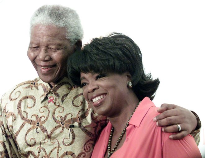 U.S. talk show personality Oprah Winfrey with former South African President Nelson Mandela during the Agenda for Earth Turning Ceremony for The Oprah Winfrey Leadership Academy for Girls in South Africa in Henley on Klip south of Johannesburg December 6,2002. REUTERS/Juda Ngwenya  JN/JV - RTREXUC